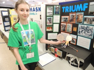 Sarah Bell with her history project on TRIUMF.