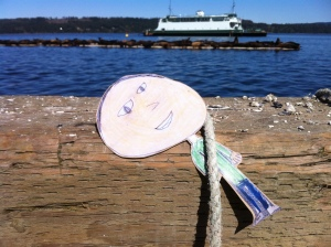 Flat Mark holds onto a rope on the government dock at Fanny Bay while watching the sea lions.