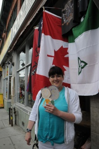 We spent an afternoon at the Byward Market, a famous shopping and eating district in Ottawa. Here is Susie by a Canadian flag.