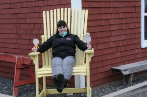 A really big Adirondack chair in front of the Tatamagouche Creamery.
