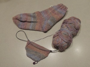 "I had only been knitting for a year when Beth S., my friend and knitting mentor, suggested I join her sock knitting class. ""You can totally do this!"" she said. It took me five—FIVE—trips back to the Village Yarn Shoppe in Comox to finish my sock, which I ultimately made into an ankle sock because I wanted to finish it! That was nearly three years ago. I finally cast on the second sock, but still have not finished it."