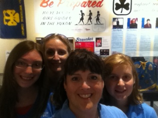 Casandra Dievert, Lynn Hooper, me and Samantha Oldale at the MacBride Museum of Yukon History, in front of a Girl Guiding exhibit.